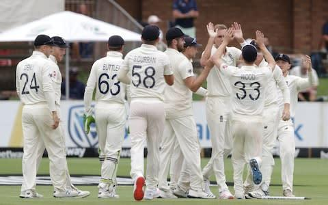 <span>Stuart Broad takes three wickets for no runs from 16 balls to polish off SA's first innings at Port Elizabeth</span> <span>Credit: RICHARD HUGGARD/AFP via Getty Images </span>