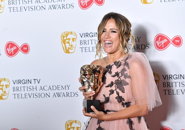 Caroline Flack poses with the BAFTA for Best Reality and Constructed Factual show at The Royal Festival Hall in 2018 (Samir Hussein/WireImage)