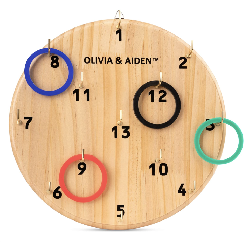 """<p><strong>OLIVIA & AIDEN</strong></p><p>amazon.com</p><p><strong>$22.99</strong></p><p><a href=""""https://www.amazon.com/dp/B07GHBT261?tag=syn-yahoo-20&ascsubtag=%5Bartid%7C10065.g.606%5Bsrc%7Cyahoo-us"""" rel=""""nofollow noopener"""" target=""""_blank"""" data-ylk=""""slk:Shop Now"""" class=""""link rapid-noclick-resp"""">Shop Now</a></p><p>This ring toss game is like darts, but cooler.</p>"""