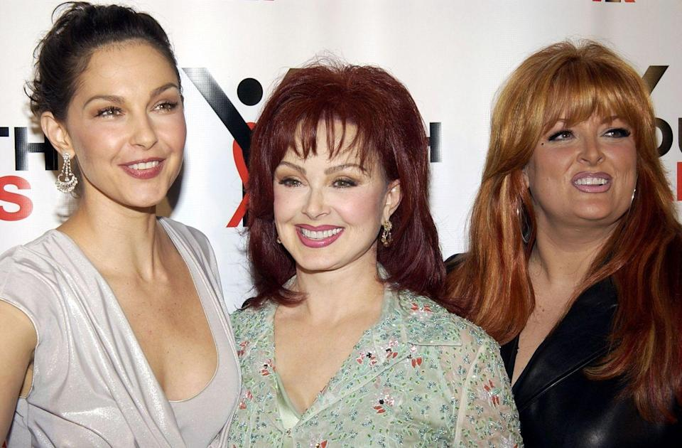 "<p><strong>Famous parent(s)</strong>: singer Naomi Judd <br><strong>What it was like</strong>: ""I loved my mother,"" Ashley <a href=""http://radaronline.com/exclusives/2011/04/exclusive-ashley-judds-painful-past-rape-drug-ordel-revealed-shocking-memoir/"" rel=""nofollow noopener"" target=""_blank"" data-ylk=""slk:wrote"" class=""link rapid-noclick-resp"">wrote</a> in her memoir, <em>All That Is Bitter and Sweet</em>. ""But at the same time I dreaded the mayhem and uncertainty that followed her everywhere...I often felt like an outsider observing my mom's life as she followed her own dreams."" </p>"