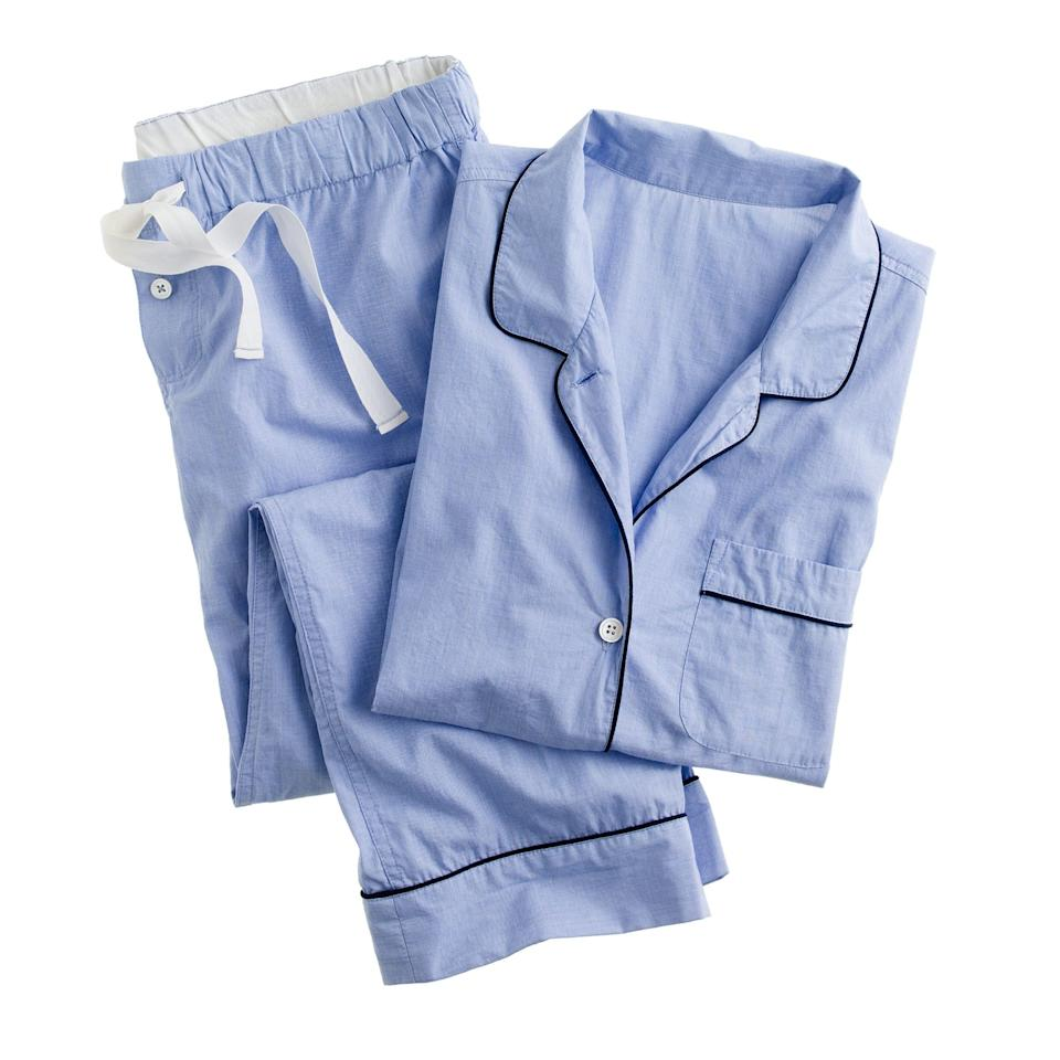 """This borrowed-from-the-boys <a href=""""https://www.glamour.com/gallery/best-pajamas-loungewear-shopping?mbid=synd_yahoo_rss"""">pajama set</a> is a cute and cozy gift for the person who plans to hibernate in style this winter. You can monogram the pocket (or the space right below it) with initials, and the set is available in four colors—including a very dreamy light pink—and comes in sizes XXS to 3X. $98, J. Crew. <a href=""""https://www.jcrew.com/p/shops/30_off_wear_now/pajamas/vintage-pajama-set/H4364?"""">Get it now!</a>"""
