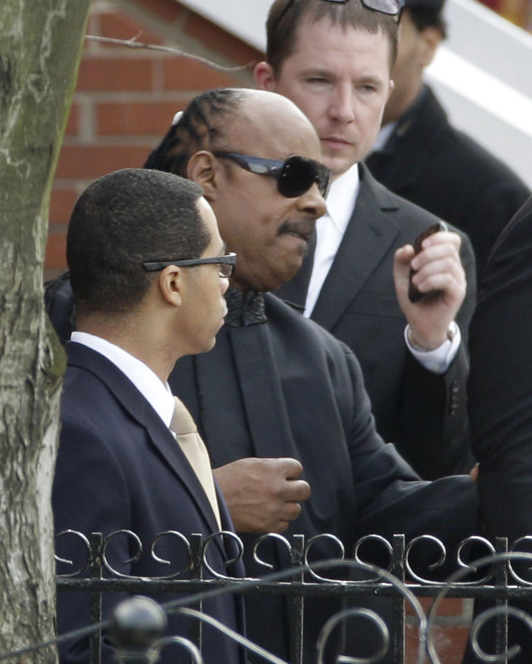 Singer Stevie Wonder, center, leaves the funeral service for Whitney Houston at New Hope Baptist Church in Newark, N.J., Saturday, Feb. 18, 2012. Houston died last Saturday at the Beverly Hills Hilton in Beverly Hills, Calif., at the age 48. (AP Photo/Mel Evans)