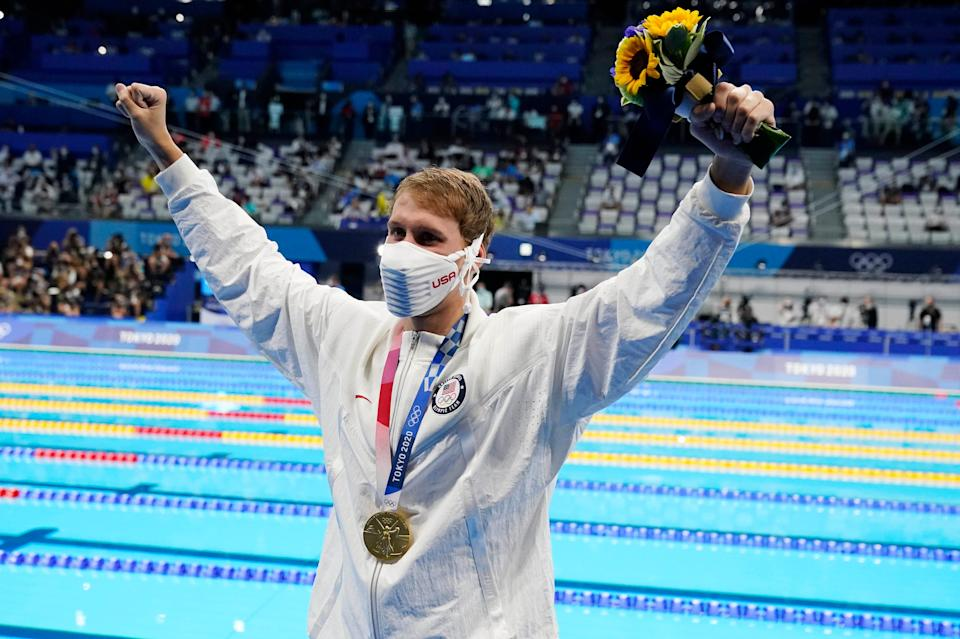Chase Kalisz celebrates during the medals ceremony for the 400-meter individual medley at Tokyo Aquatics Centre.