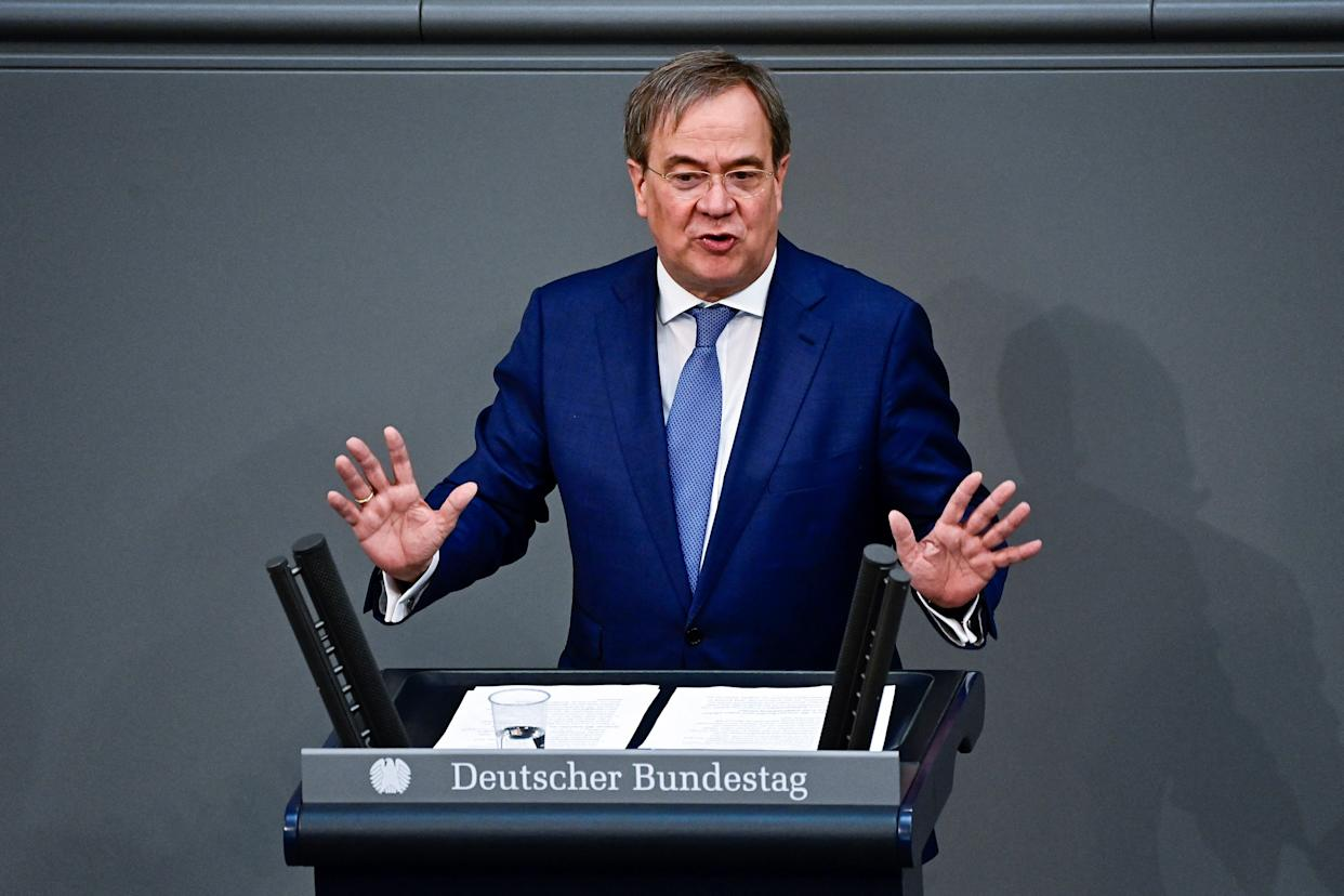 Leader of the Christian Democratic Union (CDU) party and candidate for Chancellor Armin Laschet gestures while addressing the Bundestag (lower house of parliament) in Berlin on June 24, 2021, ahead of an EU summit. (Photo by Tobias SCHWARZ / AFP) (Photo by TOBIAS SCHWARZ/AFP via Getty Images)