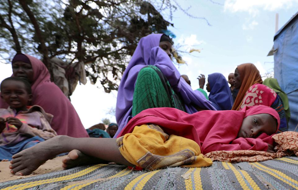 Somalis families, displaced after fleeing Southern Somalia amid an uptick in U.S. airstrikes, rests at an IDP camp near Mogadishu, on Mar. 12, 2020. | Feisal Omar—Reuters.