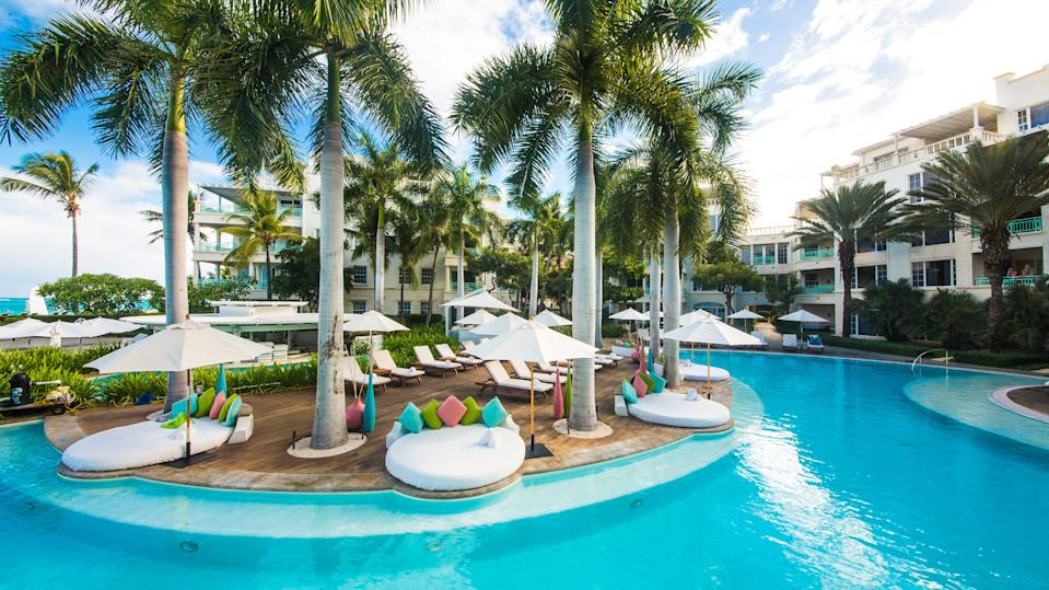 The Palms Turks and Caicos is an upscale resort steps from Grace Bay Beach.