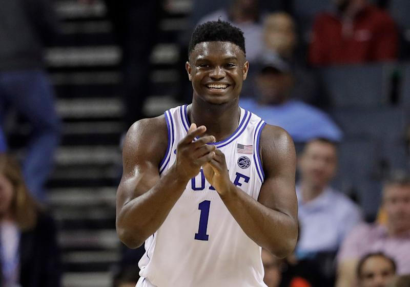 Duke's Zion Williamson (1) smiles after a play against Syracuse during the second half of an NCAA college basketball game in the Atlantic Coast Conference tournament in Charlotte, N.C., Thursday, March 14, 2019. (AP Photo/Chuck Burton)