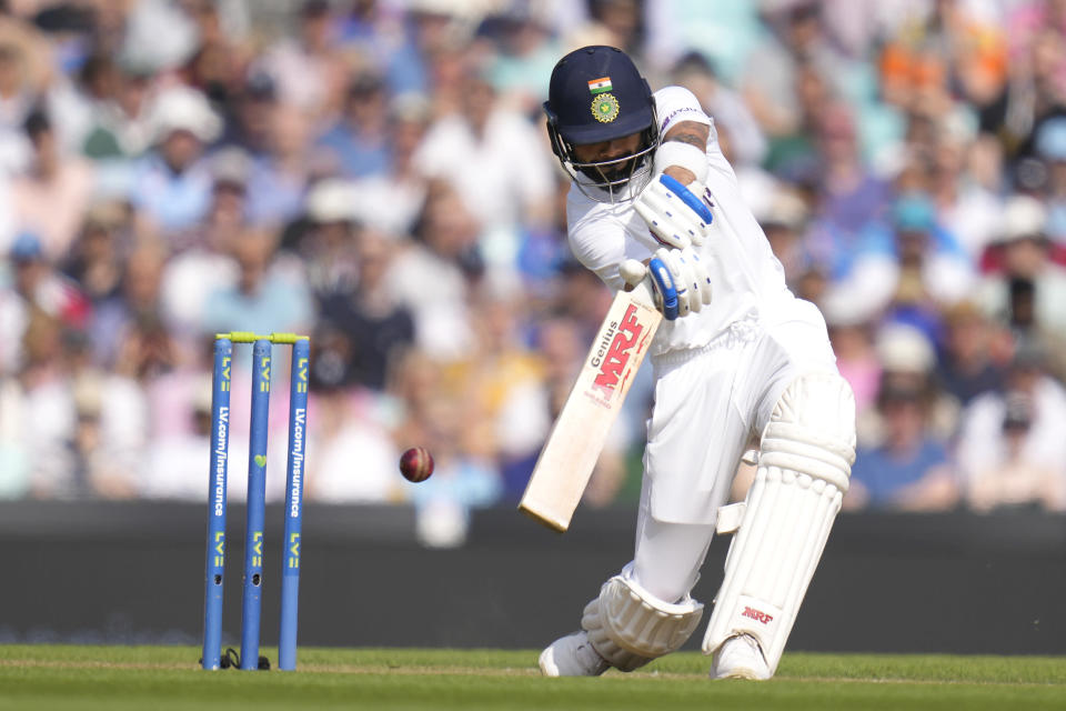 India's Virat Kohli plays a shot for four off the bowling of England's James Anderson on day four of the fourth Test match at The Oval cricket ground in London, Sunday, Sept. 5, 2021. (AP Photo/Kirsty Wigglesworth)