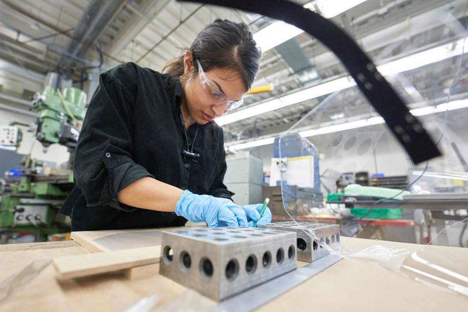 Kathleen Cornejo, project manager at University Machine Services works on assembling face shields for health care workers in the Faculty of Engineerings machine shop at Western University in London, Ontario on April 6, 2020. - The University has requested for about 14000 face shields and has partnered with local defence contractor General Dynamics to help produce them. (Photo by Geoff Robins / AFP) (Photo by GEOFF ROBINS/AFP via Getty Images)
