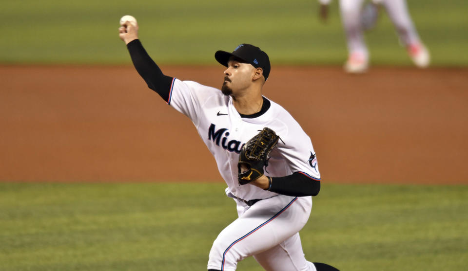 Miami Marlins' pitcher Pablo Lopez pitches against the Atlanta Braves during the first inning of a baseball game, Sunday, June 13, 2021, in Miami. (AP Photo/Jim Rassol)