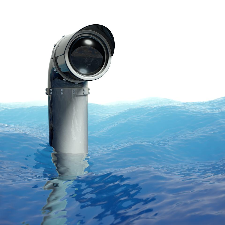 A periscope poking out of the blue ocean. Very high resolution composite 3D render.