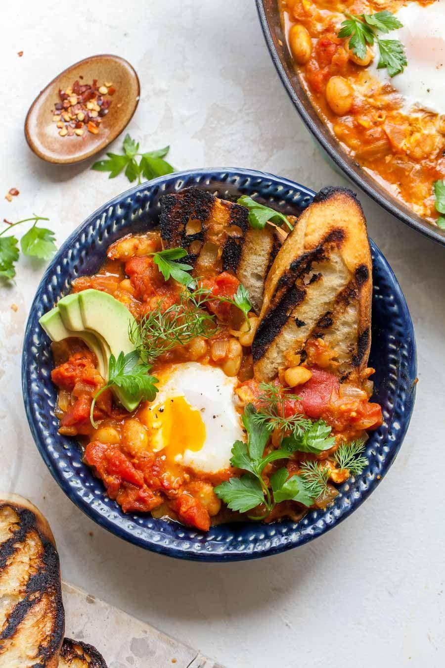 """<p>It's all the classic elements of a shakshuka, but overhauled for a single breakfast for one. This vegetarian recipe is a great brunch option on the weekends, too.</p><p><a href=""""https://dishingouthealth.com/tomato-curry-poached-eggs/"""" rel=""""nofollow noopener"""" target=""""_blank"""" data-ylk=""""slk:Get the recipe from Dishing Out Health »"""" class=""""link rapid-noclick-resp""""><em>Get the recipe from Dishing Out Health »</em></a></p><p><strong>RELATED</strong>: <a href=""""https://www.goodhousekeeping.com/food-recipes/healthy/g908/vegetarian-recipes/"""" rel=""""nofollow noopener"""" target=""""_blank"""" data-ylk=""""slk:50 Easy Vegetarian Recipes for the Whole Family"""" class=""""link rapid-noclick-resp"""">50 Easy Vegetarian Recipes for the Whole Family</a></p>"""