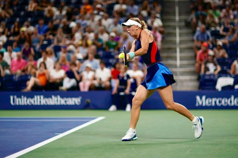 Tough night: Second-seeded Caroline Wozniacki falls in straight sets to Lesia Tsurenko in the second round of the US Open on Thursday