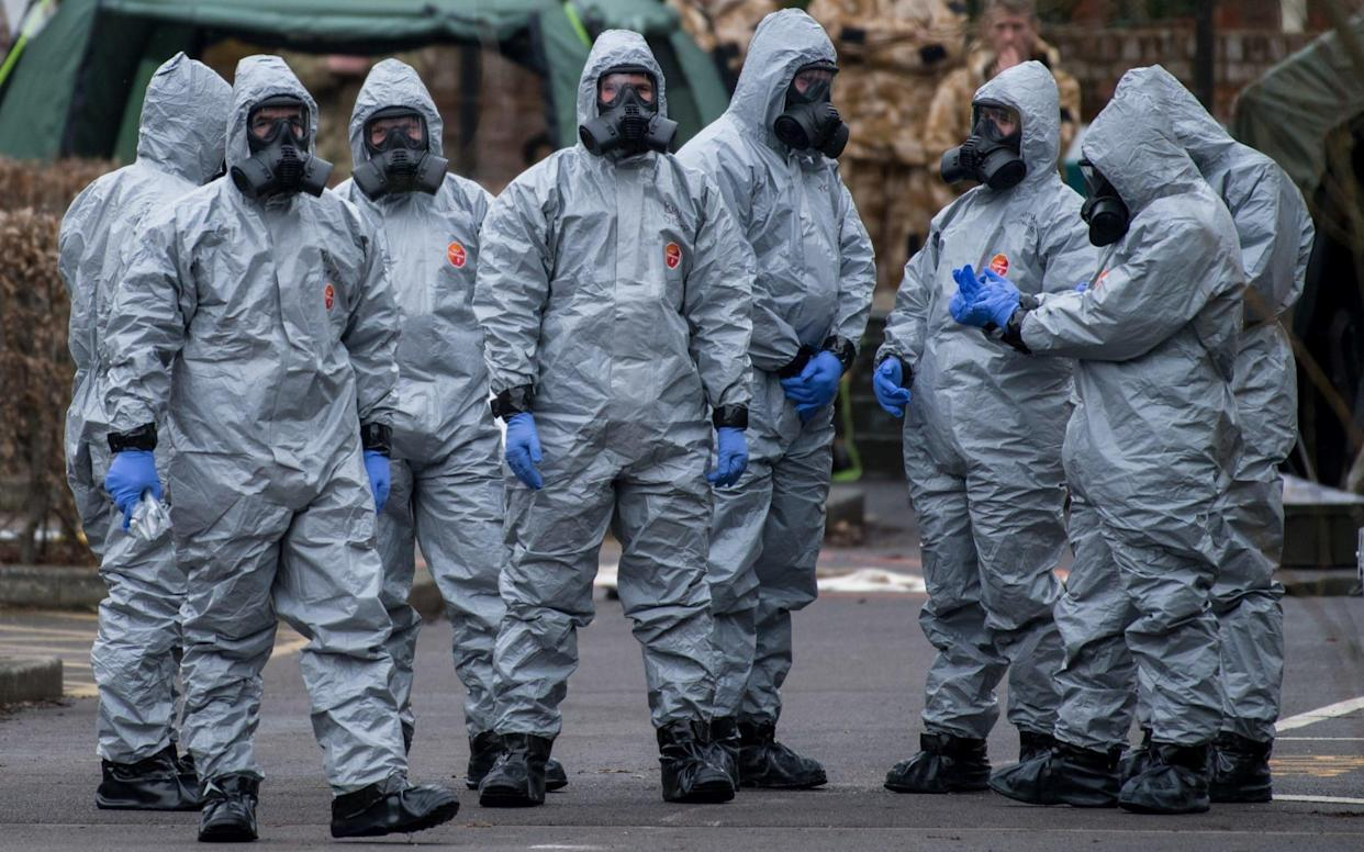 Military personnel wearing protective suits at work in Salisbury last month after the nerve agent attack  - Getty Images Europe