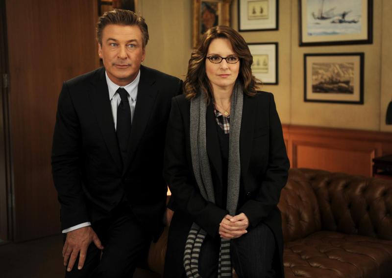 """In this 2011 image released by NBC, Alec Baldwin portrays Jack Donaghy, left, and Tina Fey portrays Liz Lemon in the NBC comedy series, """"30 Rock."""" NBC says """"30 Rock"""" will be returning next season for a final, abbreviated run. (AP Photo/NBC, Ali Goldstein)"""