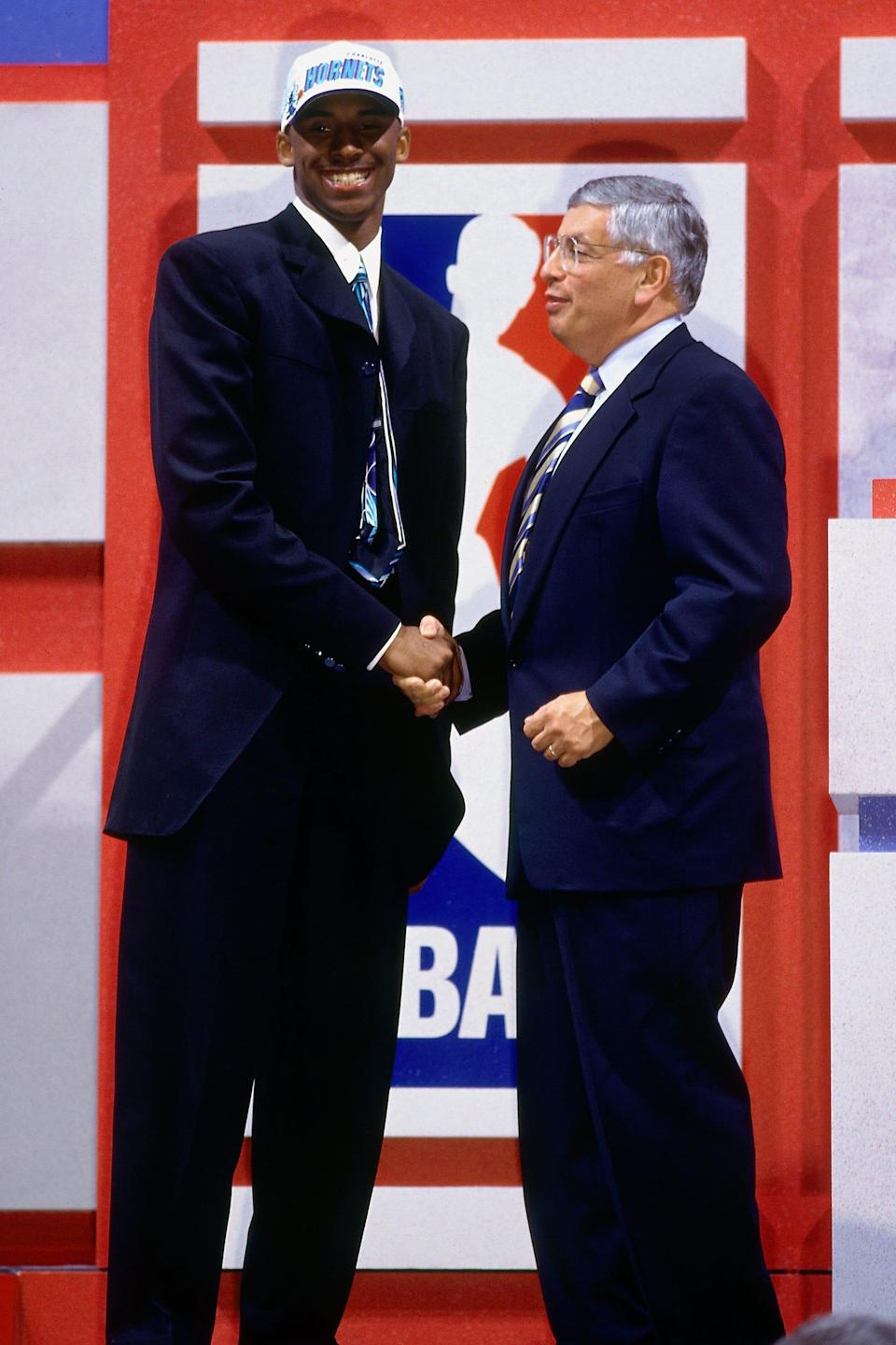 NEW YORK - JUNE 26:  Kobe Bryant poses with NBA Commissioner David Stern after being selected in the first round of the 1996 NBA Draft on June 26, 1996 at Madison Square Garden in New York, New York. NOTE TO USER: User expressly acknowledges that, by downloading and or using this photograph, User is consenting to the terms and conditions of the Getty Images License agreement. Mandatory Copyright Notice: Copyright 1996 NBAE (Photo by Nathaniel S. Butler/NBAE via Getty Images) [Via MerlinFTP Drop]