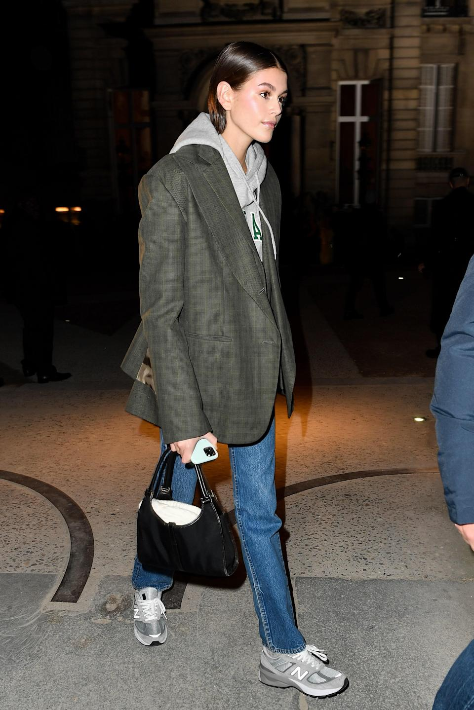 In-between shows at PFW, dad sneakers and blazers (now with Gucci a bag) dominated her wardrobe again.