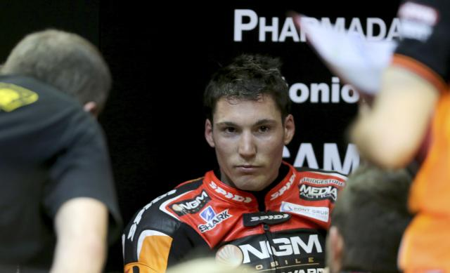 NGM Mobile Forward Racing MotoGP rider Aleix Espargaro of Spain looks on in his box during a free practice session at the MotoGP World Championship at the Losail International circuit in Doha March 21, 2014. REUTERS/Fadi Al-Assaad (QATAR - Tags: SPORT MOTORSPORT)