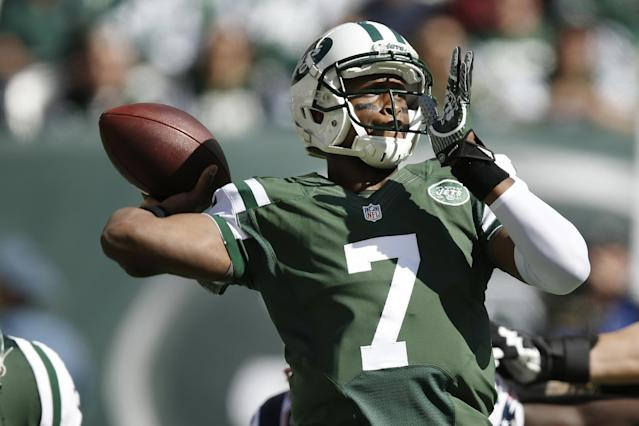 New York Jets quarterback Geno Smith (7) throws a pass during the first half of an NFL football game against the New England Patriots Sunday, Oct. 20, 2013, in East Rutherford. (AP Photo/Kathy Willens)
