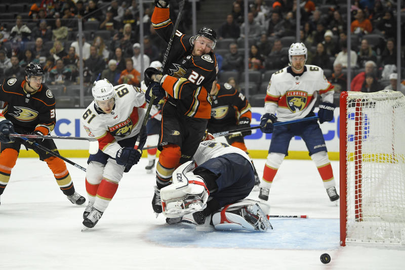Anaheim Ducks left wing Nicolas Deslauriers, third left, trips over Florida Panthers goaltender Sergei Bobrovsky, third from right, as he battles with defenseman Riley Stillman, second from left, during the second period of an NHL hockey game Wednesday, Feb. 19, 2020, in Anaheim, Calif. (AP Photo/Mark J. Terrill)
