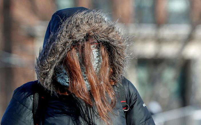 A student is dressed for subzero temperatures while walking to class at the University of Minnesota in Minneapolis on Jan. 29, 2019. (Photo: Eric Miller/Reuters)