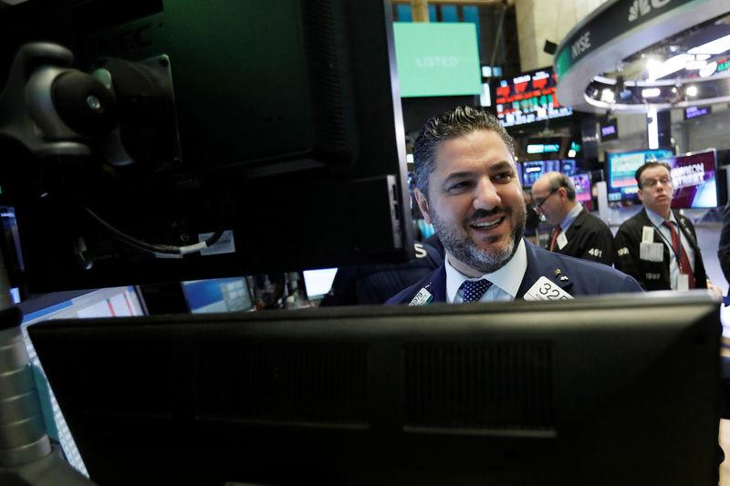 A trader works on the floor at the New York Stock Exchange (NYSE) in New York