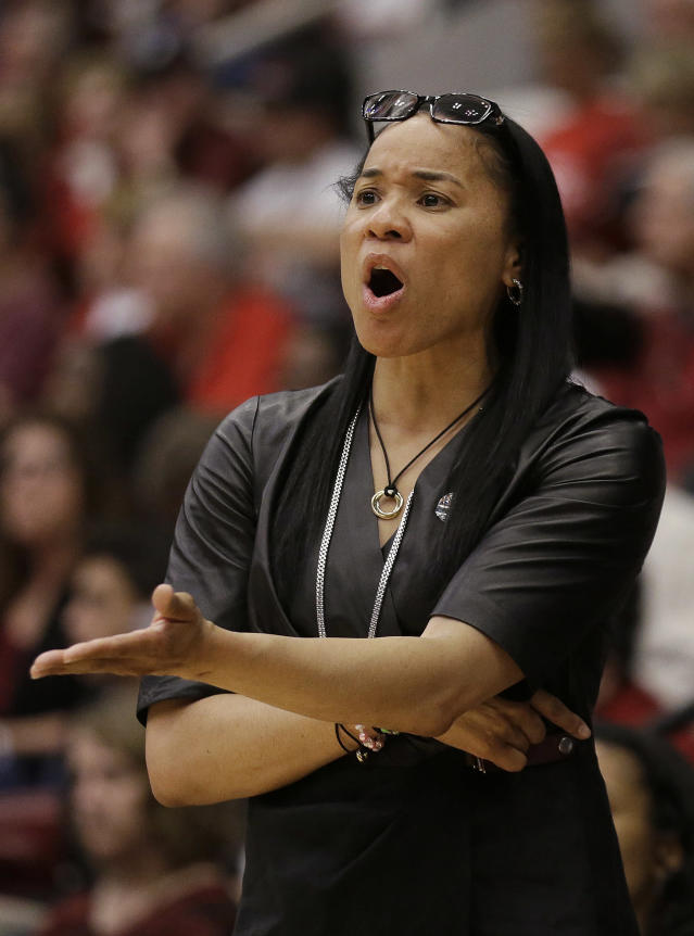 South Carolina head coach Dawn Staley talks to an official during the first half of a regional semifinal game against North Carolina at the NCAA college basketball tournament in Stanford, Calif., Sunday, March 30, 2014. (AP Photo/Jeff Chiu)