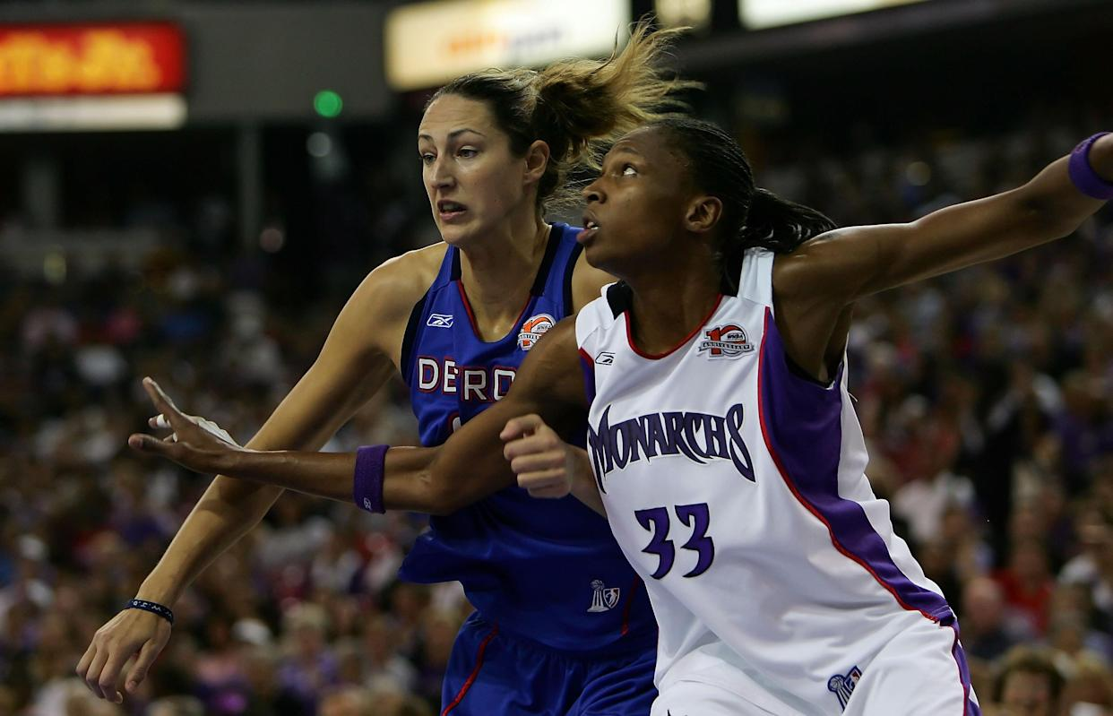 Sacramento's Yolanda Griffith fights for rebound position against the Detroit Shock's Ruth Riley during the 2006 WNBA Finals. Griffith led the Monarchs to two striaght WNBA FInals and won one championship with the franchise. (Jed Jacobsohn/Getty Images)