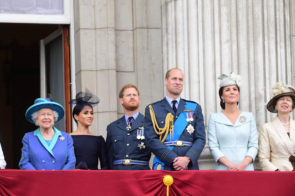Britain's Queen Elizabeth, Meghan, Duchess of Sussex, Prince Harry, Prince William, and Catherine, Duchess of Cambridge stand on the balcony of Buckingham Palace as they watch a fly past to mark the centenary of the Royal Air Force in central London, Britain July 10, 2018. Paul Grover/Pool via Reuters