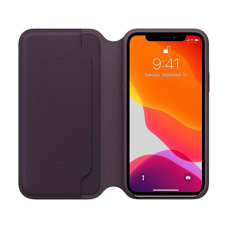 """<p><strong>Apple</strong></p><p>amazon.com</p><p><strong>$129.00</strong></p><p><a href=""""https://www.amazon.com/dp/B07XQYCGX7?tag=syn-yahoo-20&ascsubtag=%5Bartid%7C2089.g.1994%5Bsrc%7Cyahoo-us"""" rel=""""nofollow noopener"""" target=""""_blank"""" data-ylk=""""slk:Shop Now"""" class=""""link rapid-noclick-resp"""">Shop Now</a></p><p>Made of high-quality European leather, Apple's own iPhone wallet case has pockets for essential cards, and it'll automatically wake up your phone when you flip it open. </p><p>You can order the accessory in black or this eye-catching aubergine finish for the iPhone 11 Pro and the <a href=""""https://www.amazon.com/dp/B07XQRKDH7?tag=syn-yahoo-20&ascsubtag=%5Bartid%7C2089.g.1994%5Bsrc%7Cyahoo-us"""" rel=""""nofollow noopener"""" target=""""_blank"""" data-ylk=""""slk:iPhone 11 Pro Max"""" class=""""link rapid-noclick-resp"""">iPhone 11 Pro Max</a>. The case is also available for the <a href=""""https://www.amazon.com/dp/B07H9LCBH3?tag=syn-yahoo-20&ascsubtag=%5Bartid%7C2089.g.1994%5Bsrc%7Cyahoo-us"""" rel=""""nofollow noopener"""" target=""""_blank"""" data-ylk=""""slk:iPhone XS"""" class=""""link rapid-noclick-resp"""">iPhone XS</a> and <a href=""""https://www.amazon.com/dp/B07H9T59GQ?tag=syn-yahoo-20&ascsubtag=%5Bartid%7C2089.g.1994%5Bsrc%7Cyahoo-us"""" rel=""""nofollow noopener"""" target=""""_blank"""" data-ylk=""""slk:iPhone XS Max"""" class=""""link rapid-noclick-resp"""">iPhone XS Max</a>.</p>"""