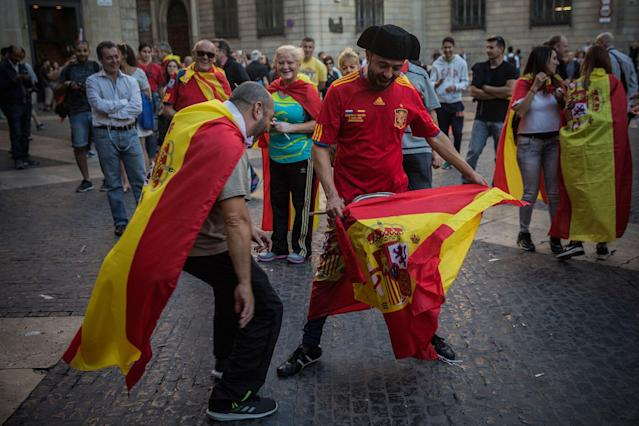<p>Men perform a bullfighting game outside the Palau Generalitat after a mass rally against Catalonia's declaration of independence, in Barcelona, Spain, Sunday, Oct. 29, 2017. (Photo: Santi Palacios/AP) </p>