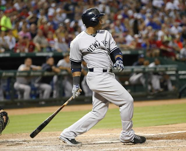 New York Yankees' Robinson Cano follows through on an RBI single against the Texas Rangers during the sixth inning of a baseball game, Wednesday, July 24, 2013, in Arlington, Texas. (AP Photo/Jim Cowsert)