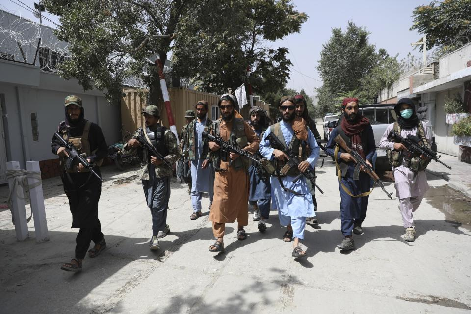 Taliban fighters patrol in the Wazir Akbar Khan neighbourhood in the city of Kabul, Afghanistan. Taliban fighters have reportedly gone door-to-door hunting for opponents. Source: AP