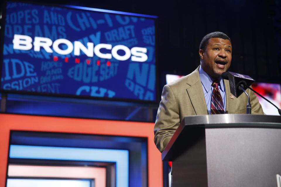 FILE - Former NFL player Steve Atwater announces that the Denver Broncos select Georgia Tech's Adam Gotsis as the 63rd pick in the second round of the 2016 NFL football draft in Chicago, in this Friday, April 29, 2016, file photo. Chances are slim the Broncos would have dethroned the defending champion Green Bay Packers in Super Bowl XXXII were it not for the outstanding play of free safety Steve Atwater. (AP Photo/Charles Rex Arbogast, File)