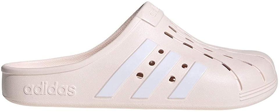 "<h2>adidas Adilette Clog Slide Sandal<br></h2><br>As of press time, it's been 16 days since Adidas launched a close-toed version of their ubiquitous Adilette slide, and the sporty rubberized shoe is already sold out on the brand's website. Luckily, we found a few on Amazon, but don't delay in carting — when the hypebeasts come for a style, you can bet it won't stick around for long.<br><br><strong>Adidas</strong> Adilette Clog Slide Sandal, $, available at <a href=""https://www.amazon.com/adidas-Unisex-Adult-Adilette-Clog-White/dp/B087CFPNP8"" rel=""nofollow noopener"" target=""_blank"" data-ylk=""slk:Amazon"" class=""link rapid-noclick-resp"">Amazon</a>"