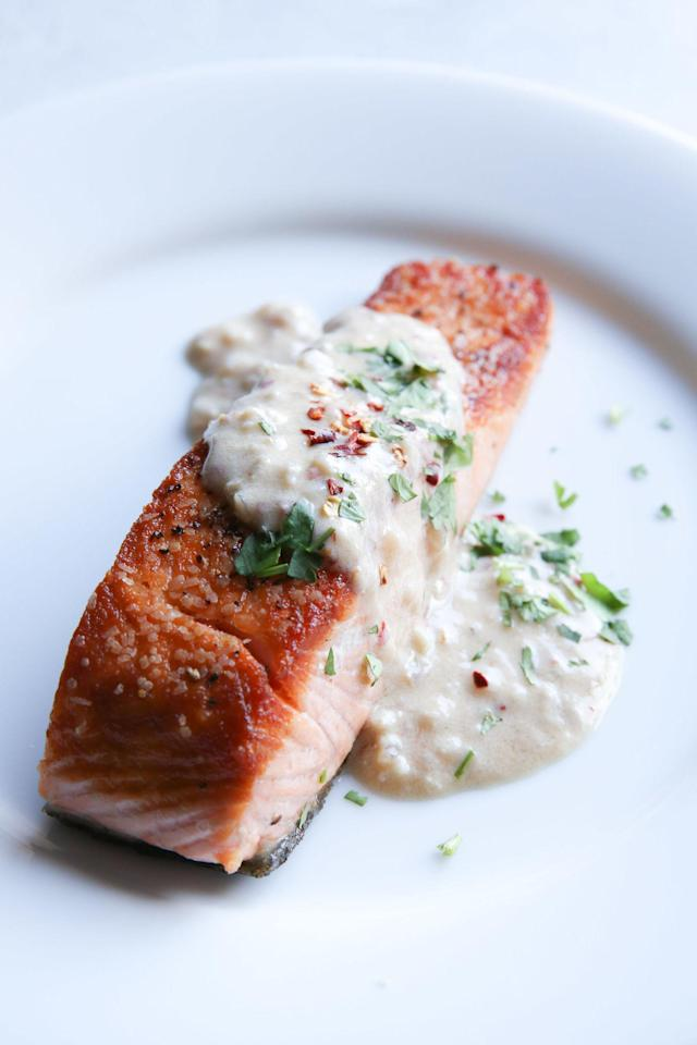 """<p>Spice up your life salmon.</p><p>Get the recipe from <a href=""""http://www.delish.com/cooking/recipe-ideas/recipes/a51340/spicy-coconut-salmon-recipe/"""" rel=""""nofollow noopener"""" target=""""_blank"""" data-ylk=""""slk:Delish"""" class=""""link rapid-noclick-resp"""">Delish</a>.</p><p><em><strong>BUY NOW: Le Creuset Cast-Iron 12"""" Skillet, $200; </strong></em><em><strong><a href=""""https://www.amazon.com/Creuset-Signature-Handle-Skillet-4-Inch/dp/B00B4UOTBQ/?tag=syndication-20"""" rel=""""nofollow noopener"""" target=""""_blank"""" data-ylk=""""slk:amazon.com"""" class=""""link rapid-noclick-resp"""">amazon.com</a>.</strong></em><br></p>"""
