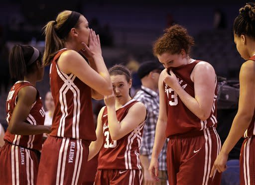 Oklahoma players,from left, Aaryn Ellenberg, Nicole Kornet, Eden Williams (33), Joanna McFarland and Portia Durrett, right, leave the court after falling to Iowa State, 79-60 in an NCAA college basketball game in the Big 12 women's tournament Sunday, March 10, 2013, in Dallas. (AP Photo/Tony Gutierrez)