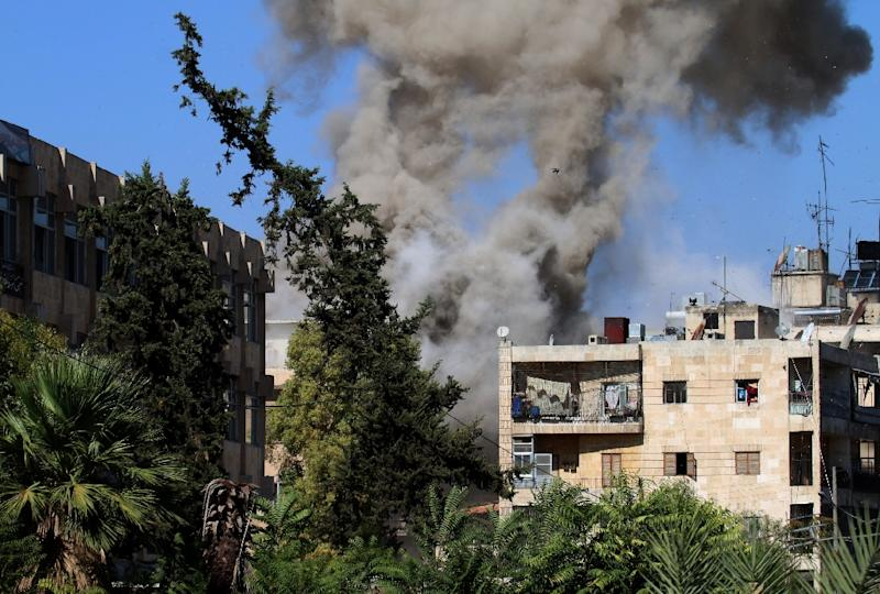 Smoke rises after reported opposition fire from buildings in an eastern government-held neighbourhood of the northern Syrian city of Aleppo on October 20, 2016