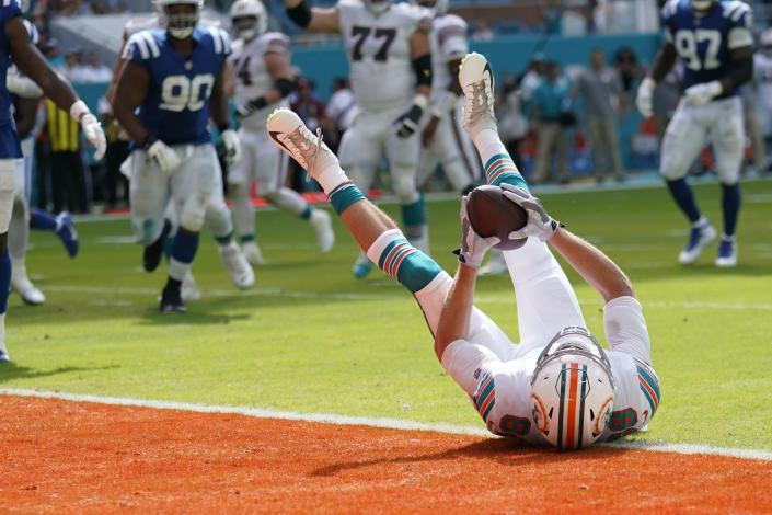 Miami Dolphins tight end Mike Gesicki (88) falls into the end zone to score a touchdown during the second half of an NFL football game against the Indianapolis Colts, Sunday, Oct. 3, 2021, in Miami Gardens, Fla. (AP Photo/Lynne Sladky)