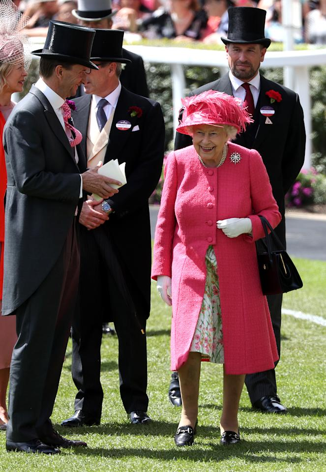 The Queen wore a raspberry pink coat, floral dress and matching hat with the Jardine Star brooch on day four. <em>[Photo: PA]</em>