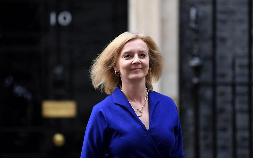 Liz Truss, the newly appointed Foreign Secretary, and the first Tory woman to hold the position, leaves 10 Downing Street on Wednesday