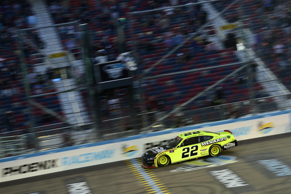 AVONDALE, ARIZONA - NOVEMBER 07: Austin Cindric, driver of the #22 Menards/Richmond Ford, crosses the finish line to win the NASCAR Xfinity Series Desert Diamond Casino West Valley 200 and the 2020 NASCAR Xfinity Series Championship at Phoenix Raceway on November 07, 2020 in Avondale, Arizona. (Photo by Jared C. Tilton/Getty Images)
