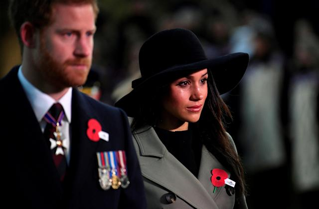 Britain's Prince Harry and his fiancee Meghan Markle attend the Dawn Service at Wellington Arch to commemorate Anzac Day in London, Britain, April 25, 2018. REUTERS/Toby Melville/Pool TPX IMAGES OF THE DAY