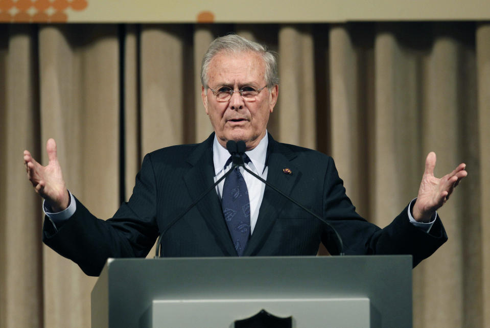 FILE - In this Oct. 11, 2011, file photo, former U.S. Secretary of Defense Donald Rumsfeld speaks to politicians and academics during a luncheon on security in rising Asia, in Taipei, Taiwan. The family of Rumsfeld says he has died. He was 88. (AP Photo/Wally Santana, File)