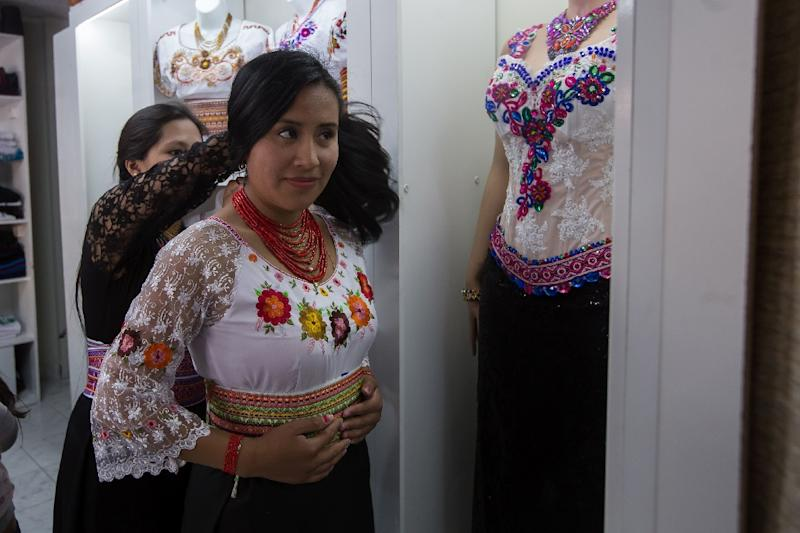 The fashion-conscious in Ecuador are returning to their roots by embracing indigenous fashion: Puruha-style hand-embroidered blouses are popular at this store in Riobamba (AFP Photo/JUAN CEVALLOS)