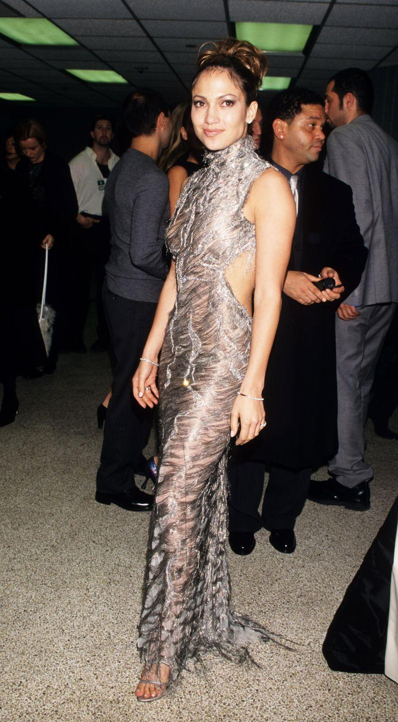 <p>J.Lo dons a statement-making backless turtleneck metallic gown and high bun to the VH1 Vogue Fashion Awards.</p>