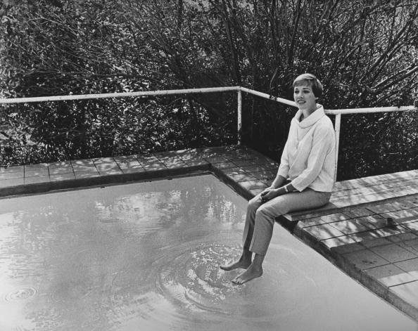 <p>Julie Andrews, poolside in November, wore capris and a casual high-collared blouse for a free-spirited ensemble.</p>