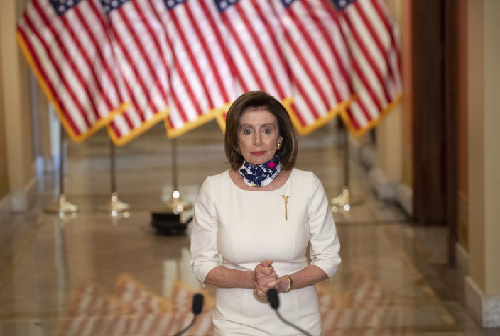 """House Speaker Nancy Pelosi of Calif., walks to speak about the so-called Heroes Act, Tuesday, May 12, 2020 on Capitol Hill in Washington. Pelosi unveiled a more than $3 trillion coronavirus aid package Tuesday, providing nearly $1 trillion for states and cities, """"hazard pay"""" for essential workers and a new round of cash payments to individuals. (Saul Loeb/Pool via AP)"""