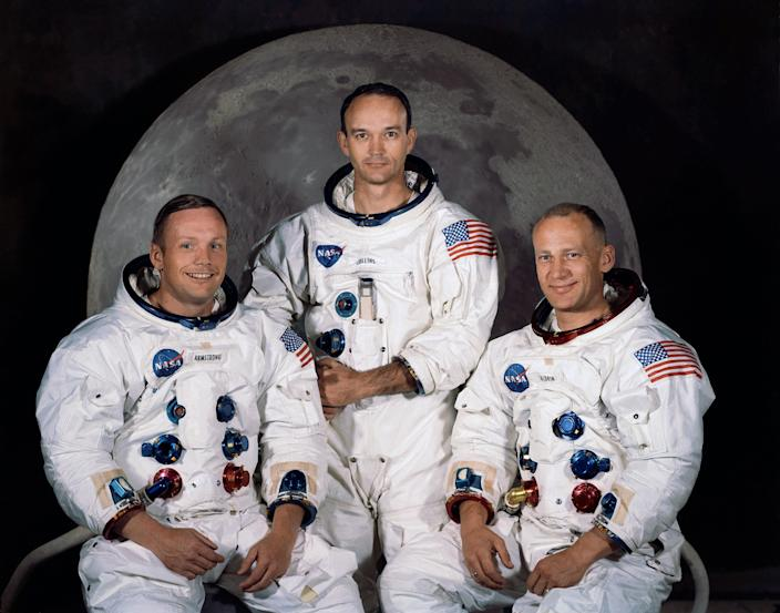 """FILE - In this 1969 photo provided by NASA the crew of the Apollo 11 mission is seen. From left are Neil Armstrong, Mission Commander, Michael Collins, Lt. Col. USAF, and Edwin Eugene Aldrin, also known as Buzz Aldrin, USAF Lunar Module pilot. The family of Neil Armstrong, the first man to walk on the moon, says he died Saturday, Aug. 25, 2012, at age 82. A statement from the family says he died following complications resulting from cardiovascular procedures. It doesn't say where he died. Armstrong commanded the Apollo 11 spacecraft that landed on the moon July 20, 1969. He radioed back to Earth the historic news of """"one giant leap for mankind."""" Armstrong and fellow astronaut Edwin """"Buzz"""" Aldrin spent nearly three hours walking on the moon, collecting samples, conducting experiments and taking photographs. In all, 12 Americans walked on the moon from 1969 to 1972. (AP Photo/NASA, File)"""