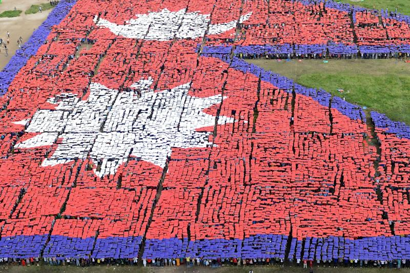 An aerial view of the Nepalese national flag, formed by over 35,000 people, is seen at the Tudikhel open ground in central Kathmandu on August 23, 2014